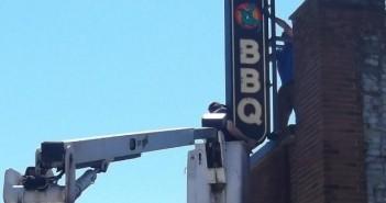 dino bbq sign