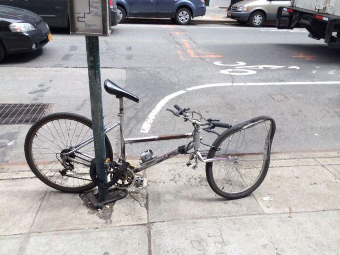 Damaged bike on 5th Ave, by neighbor Jay